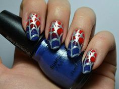 If Wonder Woman and Spider Man had a daughter her nails would look like this.