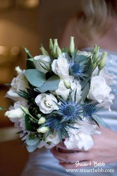 White flowers and blue thistle bouquet