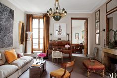 In designer Tino Zervudachi's Paris apartment, an Adam Fuss photogram is displayed above the room's Louis XVI bureau à cylindre, which is paired with a white Louis XVI chair. Paris Living Rooms, My Living Room, Living Spaces, Architectural Digest, Parisian Decor, Parisian Style, Design Apartment, Duplex Apartment, Apartment Interior