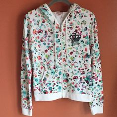 NWT Juicy Couture Zip Up Hoodie NWT Juicy Couture Zip Up Hoodie. Long sleeves, Multicolored dot design, two pockets in the front, hood with pull strings, crown design with the word Juicy on the top left in the front, zipper with J. 60% Cotton. 40% Polyester. Juicy Couture Tops Sweatshirts & Hoodies