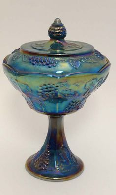 Carnival Glass : A blue carnival pedestal pot and cover : Lot 727