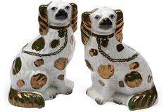 Pair of English Staffordshire spaniels with hand-painted copper luster decoration.