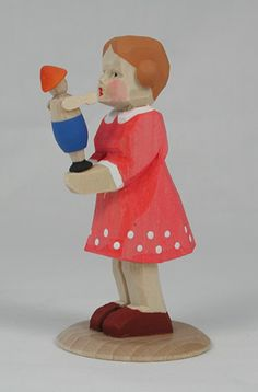 """Wonderful, hand-carved and hand-painted, wooden Girl with her Doll. She stands 3-1/4"""" tall. From the Franke Workshop, Erzgebirge, Germany. Available at www.mygrowingtraditions.com"""