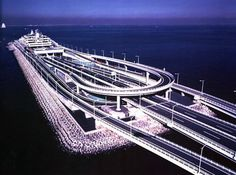The Tokyo Bay Aqua-Line (東京湾アクアライン tōkyō wan akua rain), also known as the Trans Tokyo Bay Highway, is a bridge-tunnel combination across Tokyo Bay in Japan. It connects the city of Kawasaki in Kanagawa Prefecture with the city of Kisarazu in Chiba Prefecture, and forms part of National Route 409. With an overall length of 14 km, it includes a 4.4 km bridge and 9.6 km tunnel underneath the bay—the fourth-longest underwater tunnel in the world.