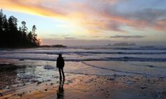A woman walks at sunset on western Vancouver Island's Halfmoon Bay beach, near Ucluelet, British Columbia. Trace amounts of radiation from the Fukushima disaster have been discovered in the area.
