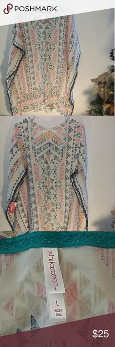 Xhilaration Beach Groove Cover! Brand New With Tags!  Beach Groove Cover or Poncho Style dress!  Vibrant Tribal printed Colors!  Oversized Fit. Xhilaration  Swim Coverups