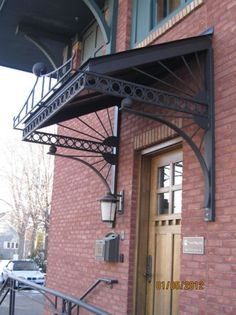 wrought iron awning frame - Yahoo Search Results Wooden Gate Plans, Wooden Gates, Awning Over Door, Metal Awning, Balcony Grill Design, Wood Pallet Planters, Custom Canopy, House Outside Design, House Front