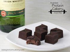 Whiskey Protein ChocolatesProt: 3 g, Carbs: 1 g, Fat: 4 g, Cal: 57 (per piece). - Andréa's Protein Cakery
