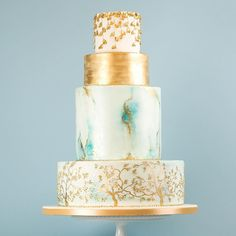 A favourite from last year. Blue and gold marbling with gold cherry blossom style trees