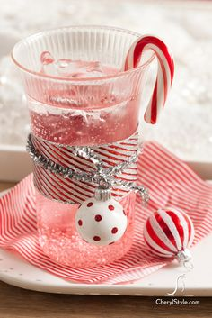 Pomegranate and grenadine sparkling mocktail.  Part Peppermint Patty, part Shirley Temple, this delicious Candy Cane Spritzer is the perfect kids Christmas drink.
