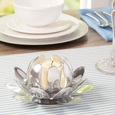 Lotus Blossom Votive Holder | Beautifully reflecting its surroundings, this set of three blossoming lotus holders is highlighted by a polished metal finish.