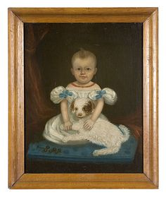 "unattributed, ca 1830-40, oil on canvas. A charming portrait depicting a boy in a puffy-sleeved gown and coral necklace, seated on a blue cushion with a puppy in his lap; in the foreground, a rattle is shown resting on the cushion. In a period pine ogee frame in natural finish; 29.5"" x 23.5"" (sight); 35.25"" x 29.25"""