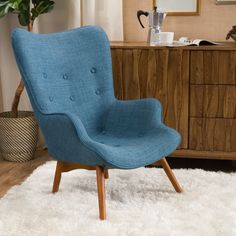 Round out your midcentury-inspired den seating group or stack plush towels in the master bath with this stylish tufted-accent chair, perfect paired with a chic shag rug or topped with a bold patterned pillow.