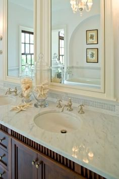 Coastal Bath! Counter and above-counter small tiles. Framed mirrors.