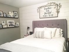 Farmhouse style, farmhouse decor, modern farmhouse, master bedroom, master bedroom decor, farmhouse bedroom, shiplap, floating shelves, picture ledge shelves, tufted headboard, white bedding, gray walls, split level bedroom, cotton stems, over the bed sign, cotton stem garland See Instagram photos and videos from Robin Norton (@rock.n.robs)
