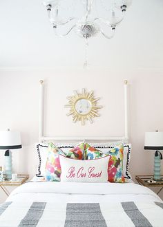 Guest Bedroom | DIY Project  | Floral Pillows | Patterned Drapes | Acrylic Chandelier | Sunburst Mirror www.styleyoursenses.com