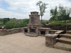 Outdoor fireplace with landscaping