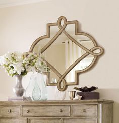 A beautifully shaped mirror may be the easiest way to bring light and a sense of well-being into a room. Photo: Hooker Furniture