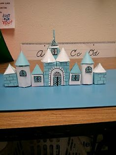 """Finished example of castle building with 3-D shapes....If 2nd grade makes these, third grade can come down to do a """"scavenger hunt"""" to see how many of each specific shape we can find @ Ann Bloomfield"""