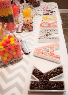 put candy or chocolates or gummy bears in large letter shaped containersthe letters could represent someones name or the occasion
