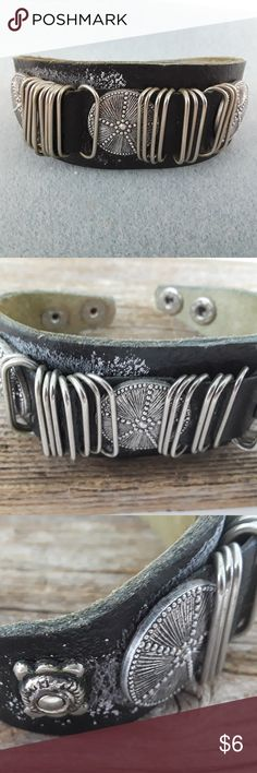 black leather and metal steampunk style industrial This is an interesting bracelet that could be steam punk or maybe industrial. It is adjustable from 7 to 8 inches. Jewelry Bracelets