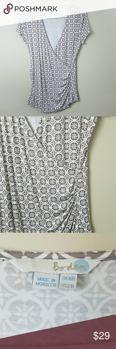 "Boden Medallion Print Wrap Front Top Boden Medallion Print Wrap Front Top.   US size 12.  Super cute and flattering style with lots of stretch.  18.5"" across the bust.  25.5"" long. Boden Tops"