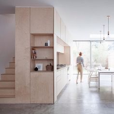 A plywood box hosts the kitchen and staircase in this minimal maisonette in Islington, which has been reconfigured and extended by local…
