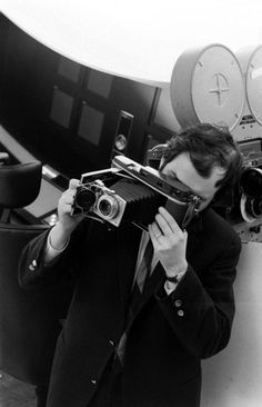 Stanley Kubrick on the set of 2001: A Space Odyssey with a Polaroid camera. By Dmitri Kessel.