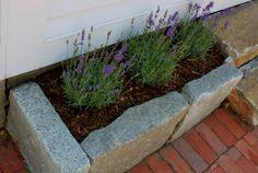 use granite cobblestones or cement blocks to construct a small planting area