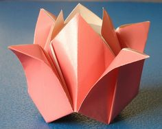 Rosa. Origami from one uncut square. Designed and folded by Francesco Guarnieri, October 2007. Diagrams in CDO Convention Book, December 2008. Diagrams, published in the book : The Biggest Ever Book of Origami by Nick Robinson.