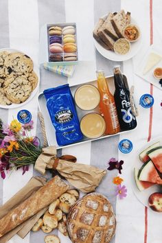 the quintessential City Park picnic: meats and cheeses from St. James Cheese Company, an overflow of freshly-baked breads from La Boulangerie, colorful macarons from Sucre and iced French Market Coffee French Roast. #ANRpicnic #AuntNellies #READsalads