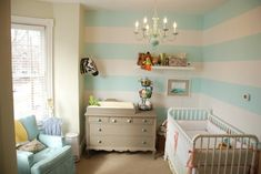 Teal, white and yellow for a nursery, so cute!  On the other side of the room are old yellow barn doors.