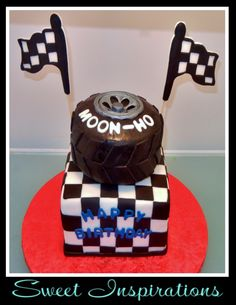 Tire, race, checkers....grooms cake with bride dragging groom topper