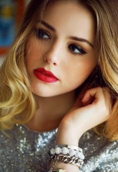 Try a bold red lip for the Blonde Bombshell look.