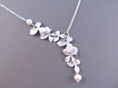 Bridesmaid Necklace, Silver Orchid Flowers with Freshwater Pearls, Bridal, Wedding Jewelry, Lariat Style Necklace. $28.00, via Etsy.