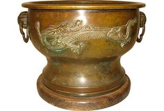 Antique bronze Japanese hibachi with dragon design and handles.