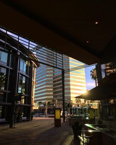 Sunset in Sherman Oaks  Exiting the theater yesterday I was greeted by this view at the Sherman Oaks Galleria. There was something about the sun the glass the shapes and the shadows that stopped me cold and made me take the photo. So much happening in one space and one moment.  #architecture #sunset #shermanoaks #sunlight #building #structure #ig_losangeles #LA #losangeles #wheream_I_LA #insta_losangeles #cali_grammers #lagrammers #losangelesgrammers #discoverla #conquer_la…