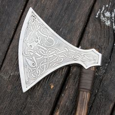 Decorative weapon – inspired by Vikings etched axe head with wolf design.
