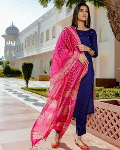 This set in blue is crafted to perfection. The set includes a straight kurta in blue which is detailed with a striking embroidery, a pair of pants in blue and a beautiful pink printed dupatta which enhances the entire look of the garment. Kurta Designs Women, Salwar Designs, Kurti Designs Party Wear, Blouse Designs, Kurtha Designs, Designer Kurtis, Indian Designer Suits, Indian Designers, Designer Kurtas For Women