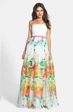 Such a beautiful chiffon and floral print organdy strapless gown for prom.
