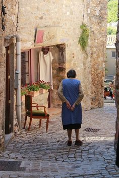 Lady in Blue. Another street scene in the beautiful village of Minerve, Languedoc-Roussillon, France.