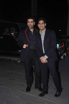 The suave directors, Karan Johar and Ayan Mukherjee, were among the handsome 'men in black' at the event. - bollywoodshaadis.com