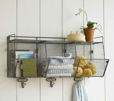 Wire shelf, organizer, and hooks. Looks perfect for a laundry room, bathroom, work shop or garage! Wire Wall Basket, Baskets On Wall, Wire Baskets, Hanging Basket, Hanging Shelves, Wall Shelves, Wall Storage, Bathroom Storage, Bin Storage