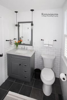 Half bath with laundry in Hanover, MA by Renovisions. Black floor tile, contrasting grout, subway tile walls, subway til Black Tile Bathrooms, Light Grey Bathrooms, Dark Gray Bathroom, Bathroom Floor Tiles, Small Bathroom, Bathroom Fixtures, Downstairs Bathroom, Bathroom Ideas, Grey Floor Tiles