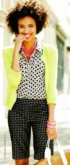 Love how they played with patterns..looks great...cardigan w/black and white ensemble and a pop of color