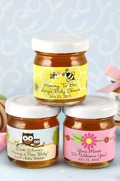 So cute for a bee themed shower or paired with tea bag favors.  Say thank you to baby shower guests with these sweet personalized honey baby shower favors. You friends and family can take them home as sovenirs or use them in hot tea during your shower. To order, visit http://www.tippytoad.com/personalized-baby-shower-honey-jars.asp