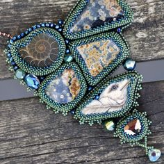 Seed bead embroidery jewerly featuring gemstones with a soft suede backing, showcasing elabroate designs set in hundres of tiny beads!