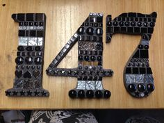 Mosaic house numbers...black tiles with charcoal grout.