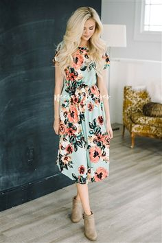 This dress is so soft, so comfy and oh so cute! Beautiful mint colored spring dress features short sleeves, a pretty watercolor floral print, an elastic waist and has cute front pockets.