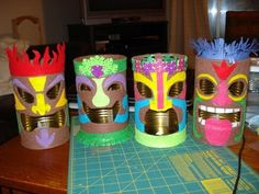 Tin Can Tiki Lamps. I could make these with my camp kids with oatmeal containers!